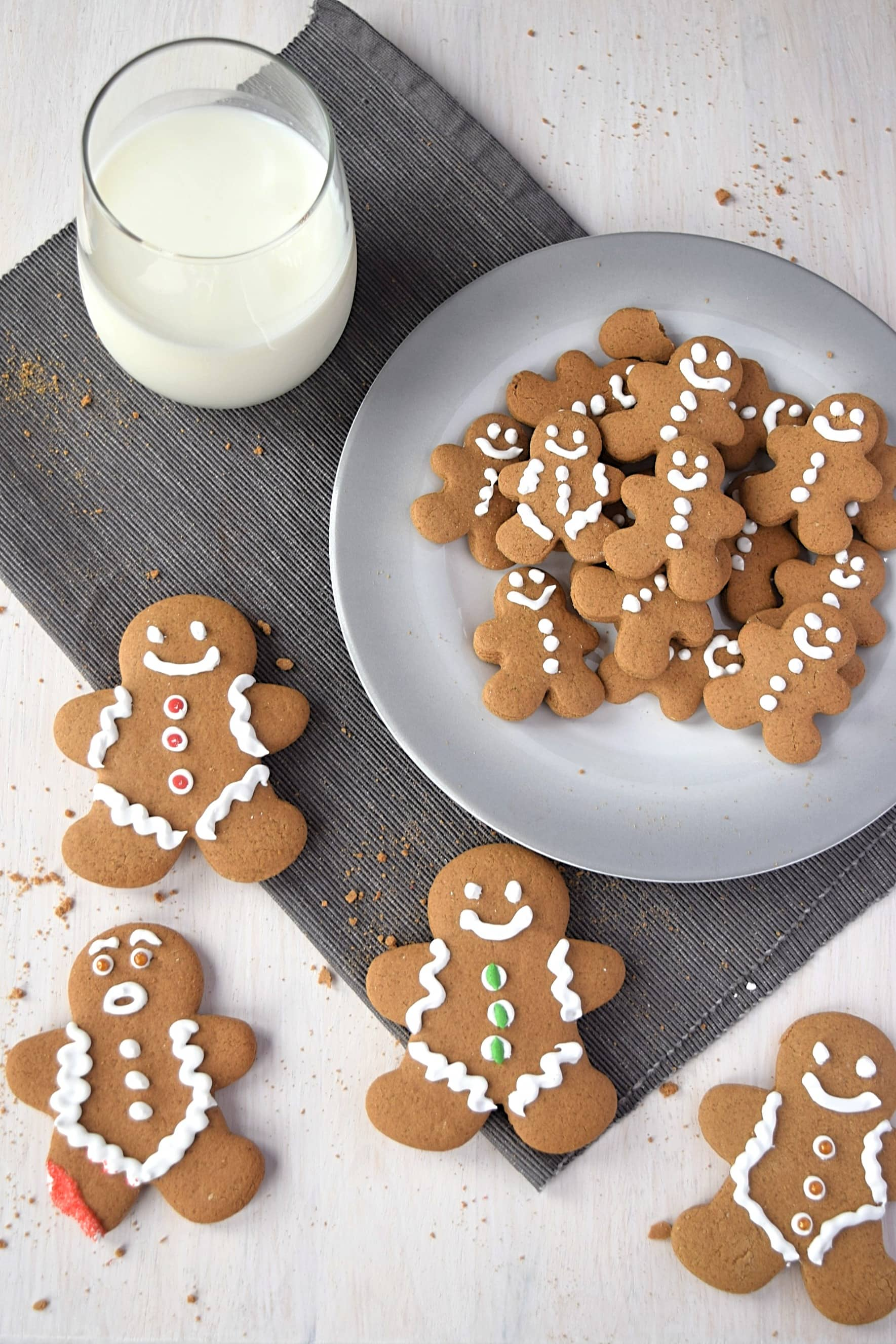 gluten free gingerbread cookies with a glass of milk